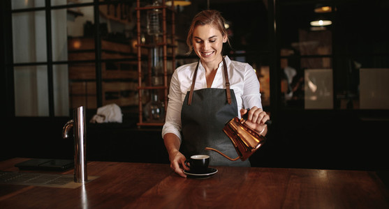 Female barista preparing coffee