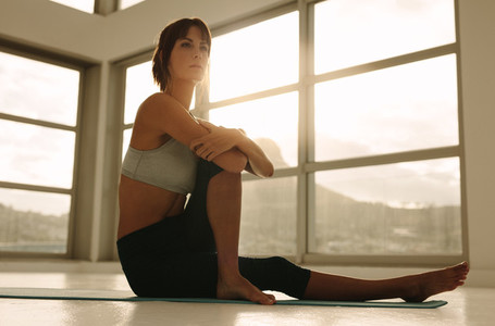 Woman practicing yoga workout at health center