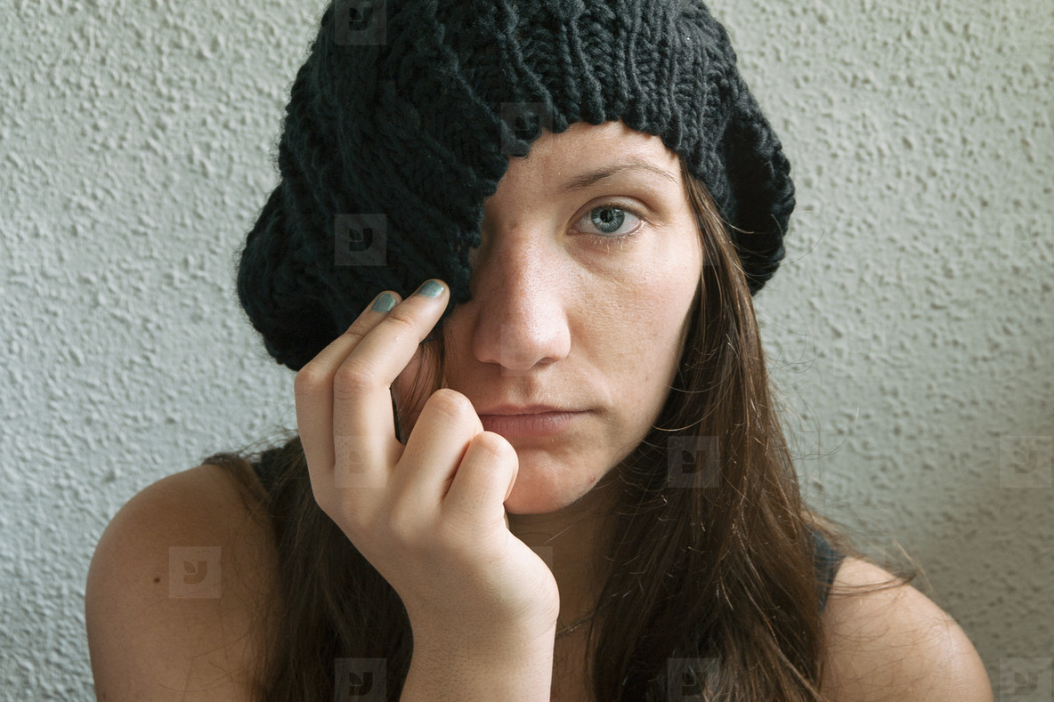 girl with long hair and blue eyes partially covering her face wi
