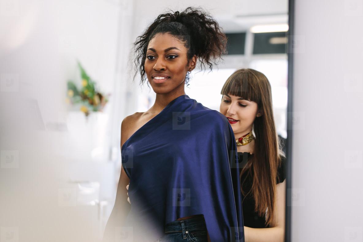 Fashion designer working on designs in her fashion design studio