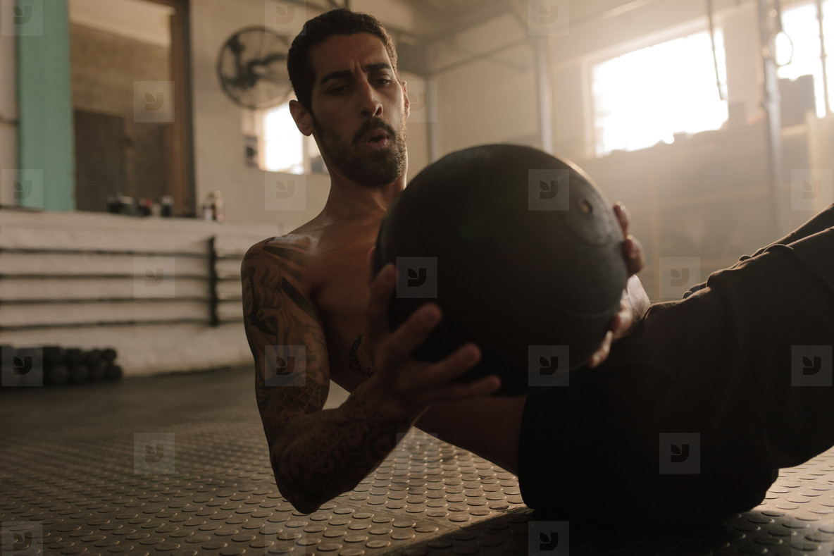 Sportsman working out with fitness ball