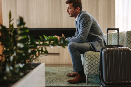Businessman eagerly waiting for this flight