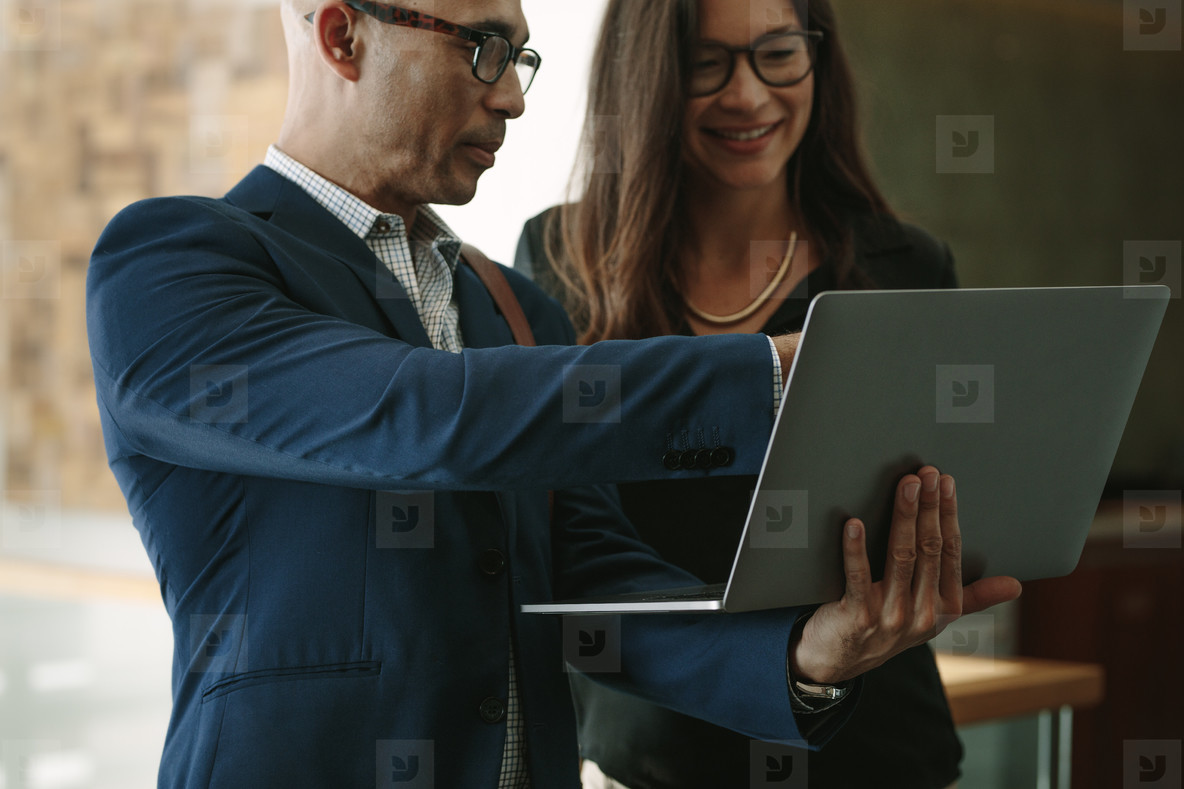 Business partners in office working on a laptop