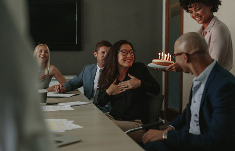 Surprise birthday celebration of a associate during meeting