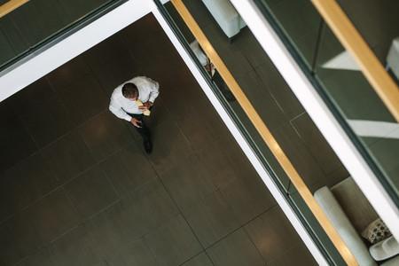 Businessman walking through office lobby