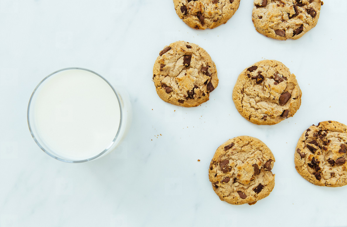 Milk and cookies on white background