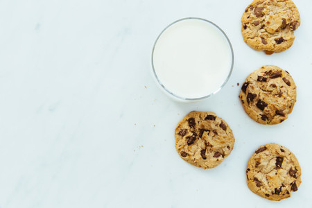 Milk and cookies on white background with copy space