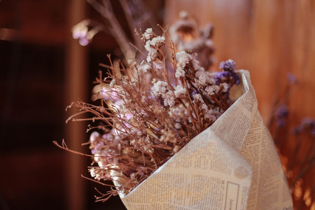 Soft focus of dried flowers in newspaper wrap for decoration