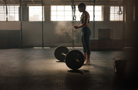 Strong woman preparing for weightlifting workout