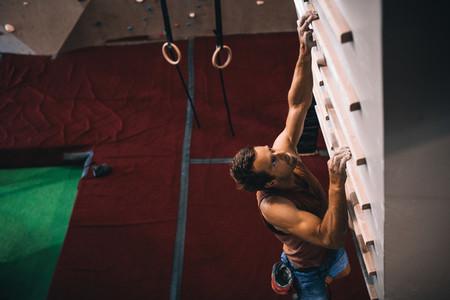 Man training on a campus board