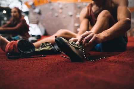 Man wearing wall climbing shoes