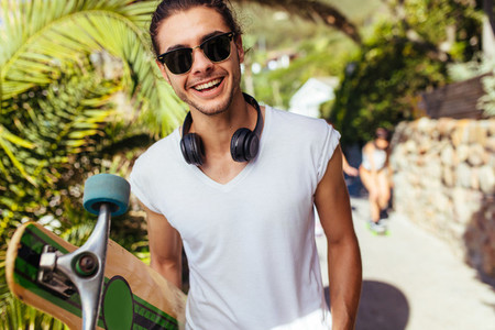 Handsome young man on vacation with longboard