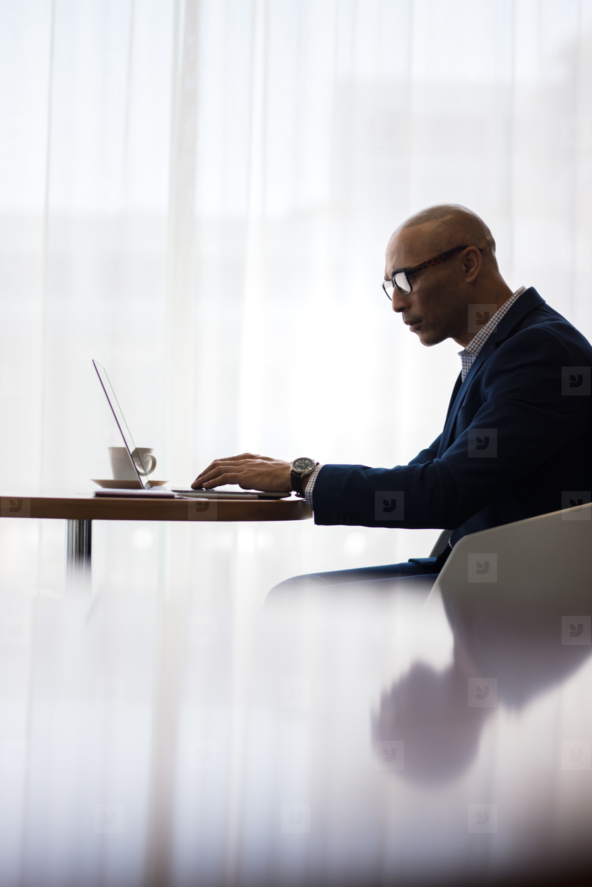 Office worker using laptop at office