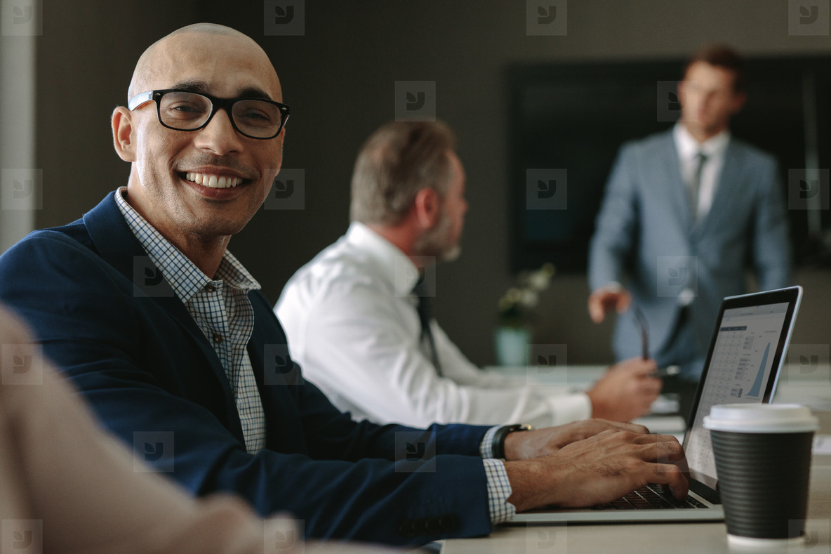 Smiling businessman during a meeting in conference room