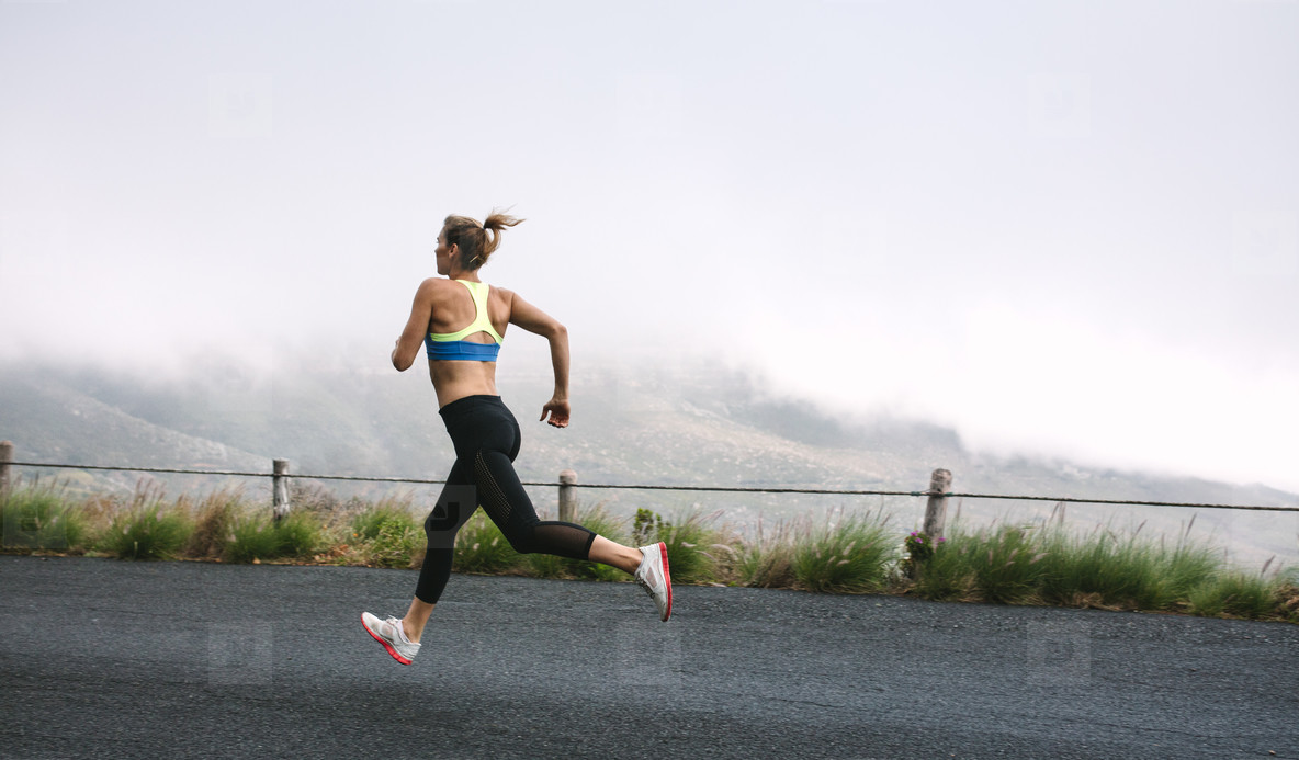 Woman athletes running on road