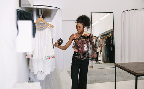 Woman entrepreneur at her fashion boutique