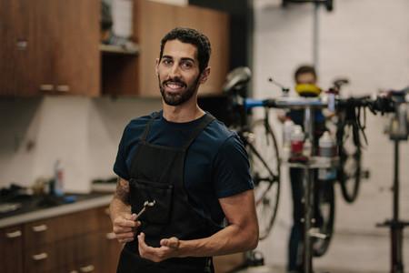 Workers repairing bicycles in workshop