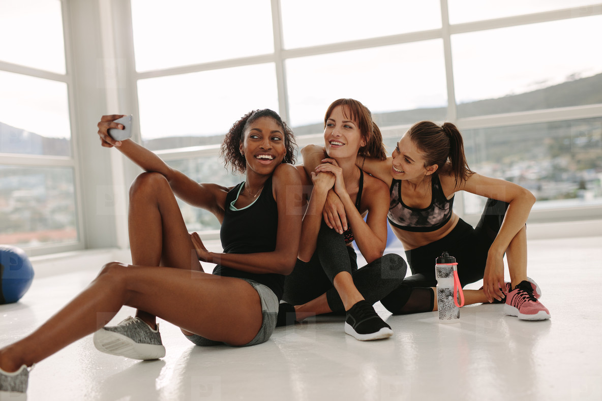 Group of female taking selfie in gym