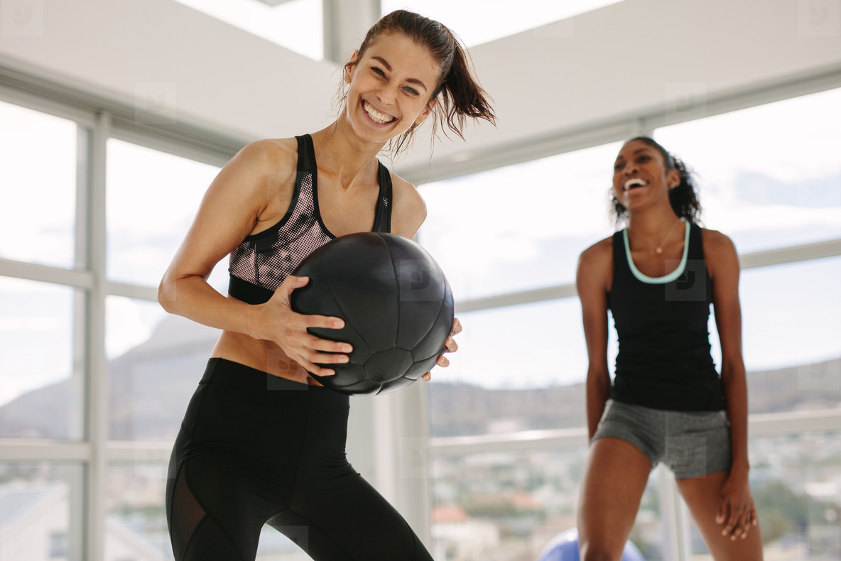 Girls working out in fitness studio with medicine ball