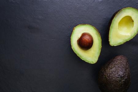 Avocado half on dark background