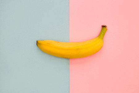 Banana fruit on bright pink and blue background
