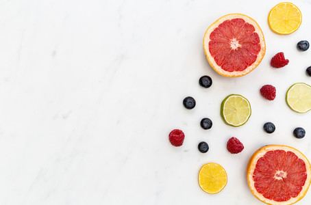 Fruit berries food background on white marble