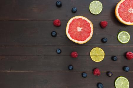 Fruit berries on dark wood background