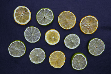 Lemon lime slices food on dark background