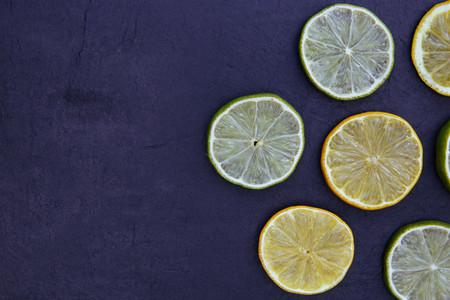 Lemon lime slices food on dark background