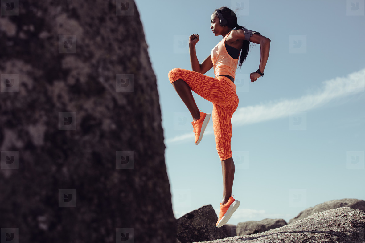 Woman doing warm up exercises outdoors