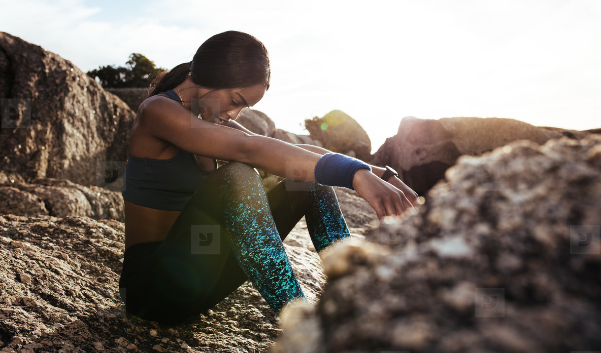 Female athlete taking rest after fitness training
