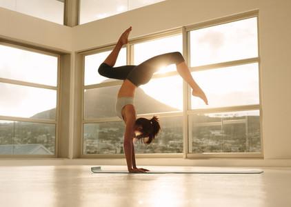 Yogi practicing handstand yoga pose