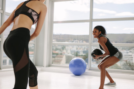 Females exercising with medicine ball