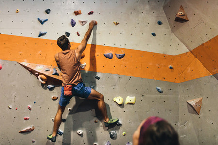 Man climbing indoor boulder wall