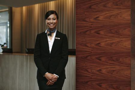 Female receptionist working in hotel
