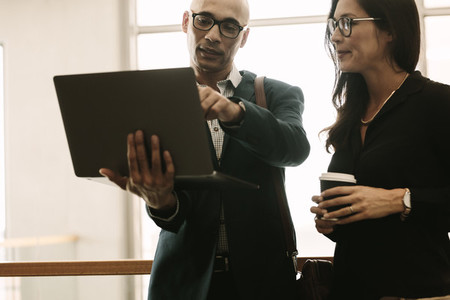 Business team working together on laptop in office
