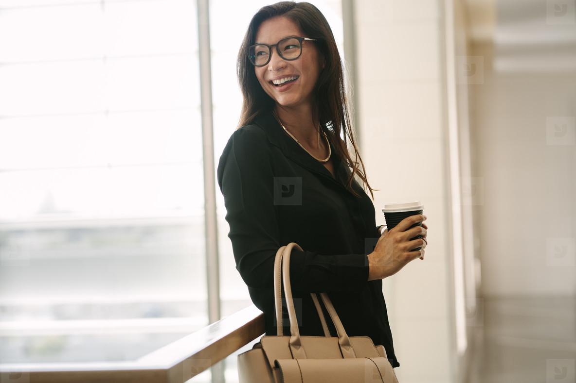 Asian business woman during coffee break