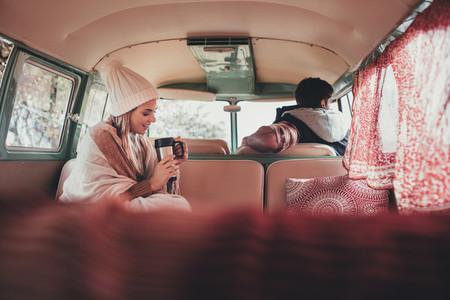 Friends on road trip travelling by van