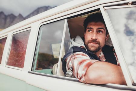 Handsome guy driving a minivan