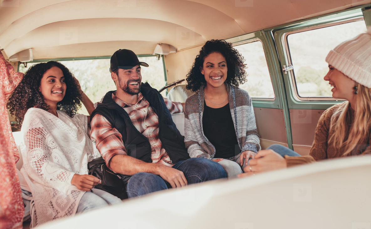 Group of friends enjoying on road trip