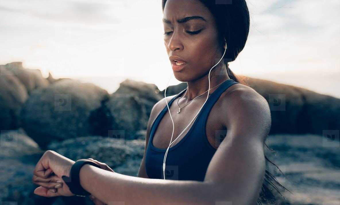 Sportswoman checking fitness progress on her smartwatch