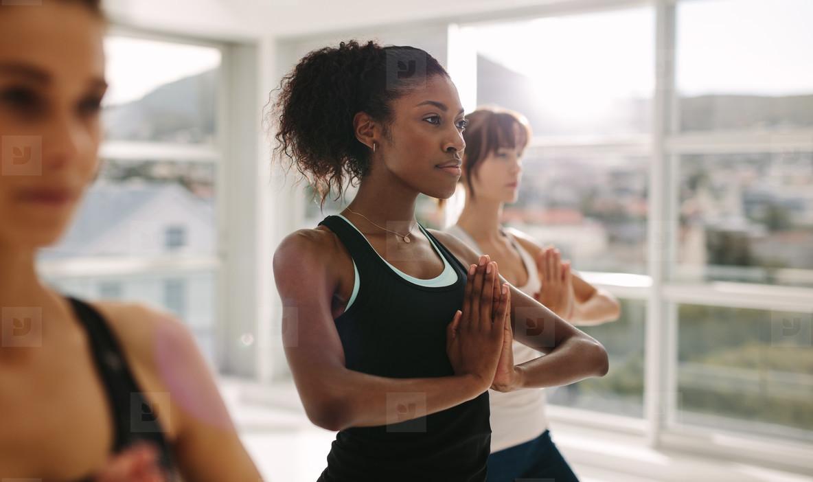 Women practices yoga in class