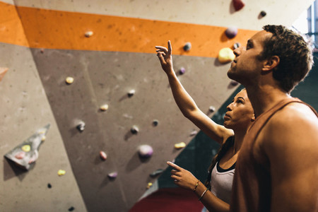 Man and woman at an indoor rock climbing gym