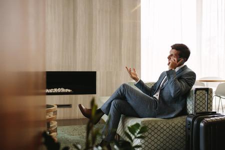 Entrepreneur at airport business lounge making phone call