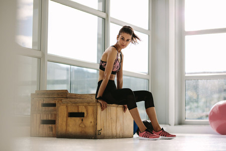 Female taking rest after fitness training