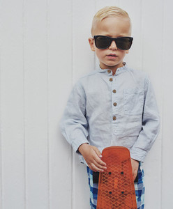 Serious small boy in modern sunglasses