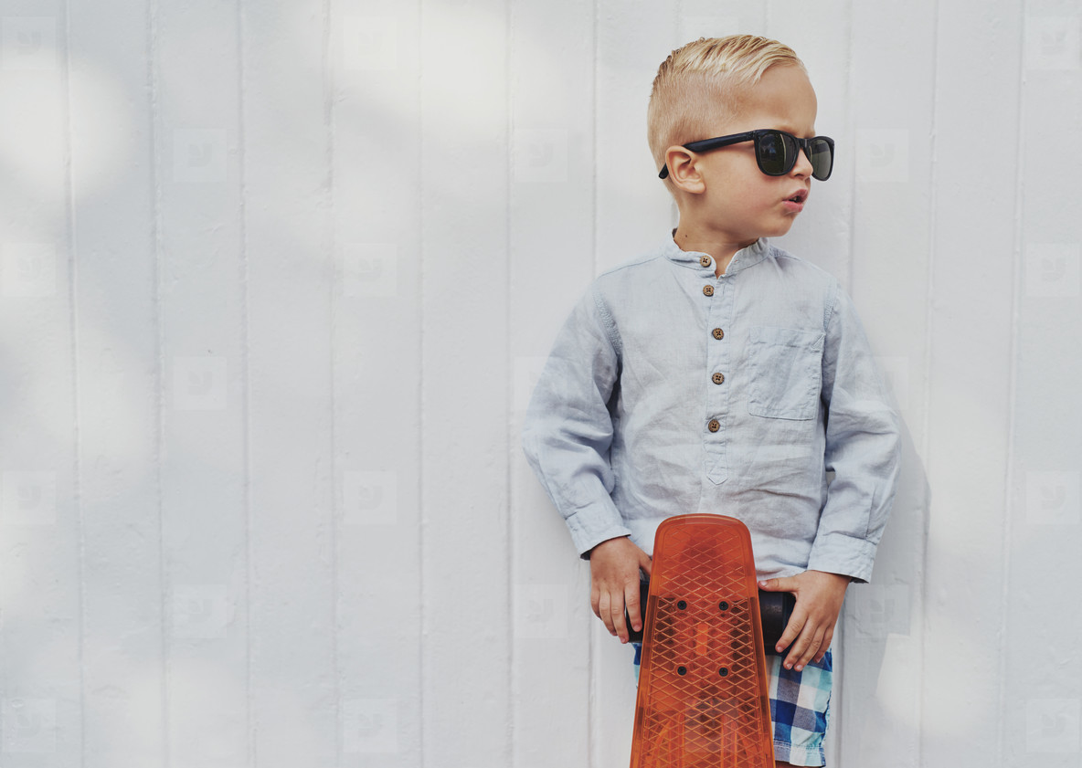 Cute little guy in big trendy sunglasses