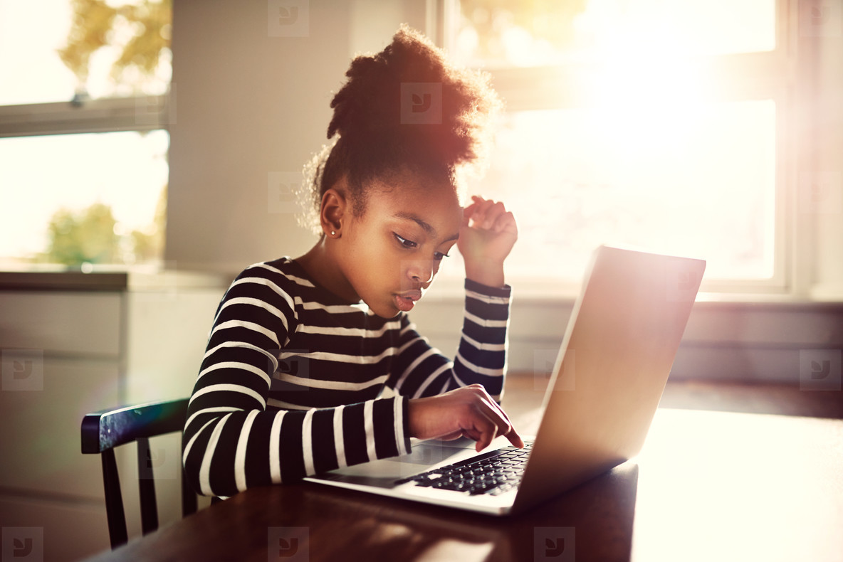 Young girl working on her homework