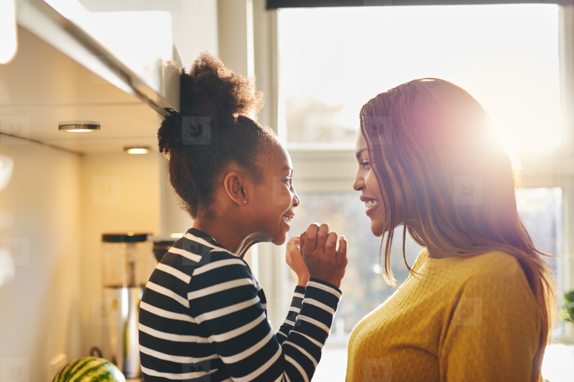 Black woman and little daughter smiling