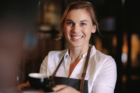 Female barista inside a coffee shop